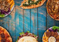 Top down view on traditional turkish meals on vintage wooden table. Royalty Free Stock Image