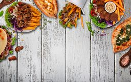 Top down view on traditional turkish meals on vintage wooden table. Royalty Free Stock Photos
