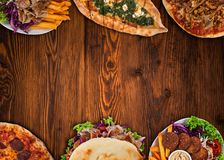Top down view on traditional turkish meals on vintage wooden table. Stock Photography