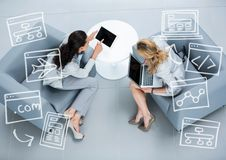 Top down view of two business women with white business doodles Royalty Free Stock Image