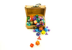 Top down of wooden chest overflowing with dice Stock Photography