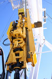 Top drive. An upward view of a yellow top drive and blocks  on a drilling rig Stock Photo
