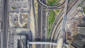 Beautiful top drone aerial view on long busy highway road in urban Dubai city modern panorama