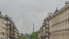 Top of Eiffel Tower between Parisian buildings in downtown Paris, France royalty free stock photo