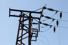 Top of electrical transformer pylon, photo of electric wires aga stock photography
