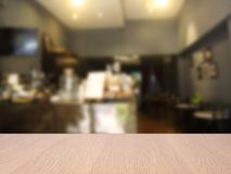 Top empty wood table on blurred abstract cafe background. royalty free stock photo