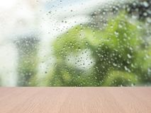 Top empty wood table on blurred abstract water drop on glass. Background. can be used for display or montage your product Royalty Free Stock Image