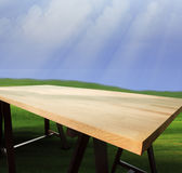 Top of empty wood table with natural green grass field and blue Royalty Free Stock Photography
