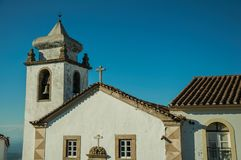 Top facade of church and below tower decorated in baroque style. In a sunny day at Marvao. An amazing medieval fortified village perched on a granite crag in royalty free stock photos