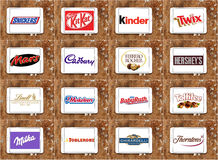 Top famous chocolate brands and logos. Collection of vector and logos of most popular chocolate companies on white tablet on rusty wooden background.brands like Royalty Free Stock Photos