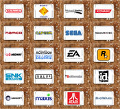 Top famous video game companies and developers logos. Collection of brands and icons of most popular video game makers on white tablet on rusted wooden Stock Photo