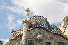 Top features with emblematic chimney of Gaudi building in Barcelona. Decorative facade with tiles and chimney at top of Gaudi's building in Barcelona, Spain Royalty Free Stock Photos
