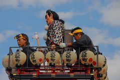 On top of a festival float. Male doll and participants of the Kawagoe Festival on top of a float decorated with paper lanterns. The festival with a history of Royalty Free Stock Images