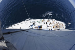 Top Fisheye Lens View Of Sailboat At Sea. Top fisheye lens view of sailboat at the blue sea royalty free stock image
