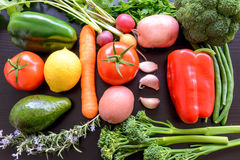 Top flat lay view of fresh organic vegetables. On wooden table Royalty Free Stock Images