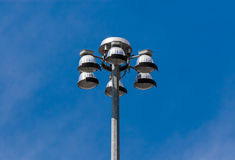 Top of flood lights pointing down on sky Royalty Free Stock Photography