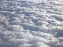 On top of fluffy curvy clouds Royalty Free Stock Photos