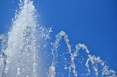 Fountain water and sky. Top of a foamy fountain water against clear blue sky Stock Photos