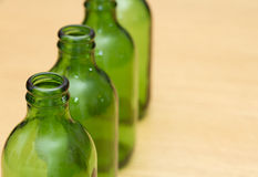 Top of four green bottles Royalty Free Stock Photos