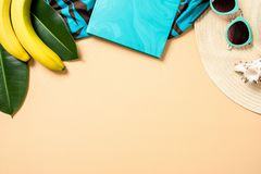 Top frame border of summer woman accessories and fruits on yellow background with free space for text. Travel vacation concept. Summer background. Beach frame stock photos