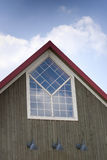 Top of A-frame building with custom window Stock Images