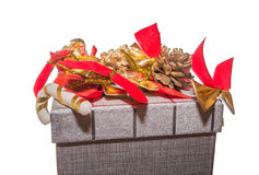 Top of gift box decorated with red bows and pine cones. Christmas decorated gift box. Top of gift box decorated with red bows and pine cones. Decorated gift box Royalty Free Stock Photos