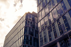 Top of Glass Buildings with Clouds Split Toning Royalty Free Stock Image