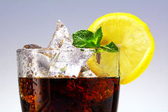 Top of a glass of cola or coke with ice cubes, lemon slice and p Royalty Free Stock Photography