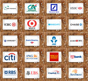 Top global banks brands and logos. Group of logos and brands of famous worldwide top banks on white tablet on rusted wooden background. banks like deutsche bank Stock Image