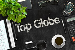 Top Globe - Text on Black Chalkboard. 3D Rendering. Stock Images