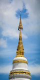 Top of golden stupa at Buddhist temple Royalty Free Stock Photo
