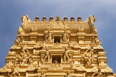 Top of golden tower at Sri Nageshwara in Bangalore. Royalty Free Stock Image