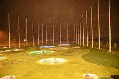 Top Golf golfing complex at Ashburn. Heavy rain and golf complex is surrounded by golf balls in night time royalty free stock photography
