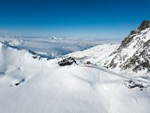 Top gondola drone shot of winter resort with avalanche area Stock Photography