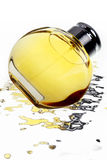 Top-grade perfume. A bottle of top-grade perfume on reflection liquid background Royalty Free Stock Photos