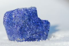 Top Grade Rough Rich Blue Lapis Lazuli with golden pyrite and white calcite inclusions from Afghanistan on white snow