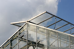 Top of Greenhouse. The top of a modern greenhouse, with it's glass panels open to let in fresh air royalty free stock photos