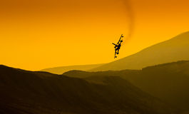 Top Gun fighter jet. Fighter jet flying in evening light in this Top Gun styled sunset shot stock photography
