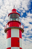 Top Half of Historic Lighthouse. Looking up at an old, red and white historic maritime lighthouse in daytime royalty free stock photos