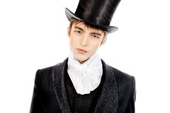 Top hat. Portrait of a young gentlemen wearing dinner jacket and black top hat. Shot in a studio Royalty Free Stock Images