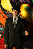 Top hat. Young ma in top hat and cane against abstract background Stock Images