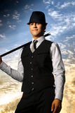 Top hat and cane. Young confident man in top hat and cane against beautiful sky background Stock Photo