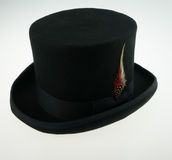 Top hat with feather. Top hat wool with feather Stock Image