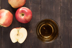 Top healthy apple juice drink and red apples fruits on wooden ba Stock Images
