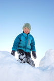 On top of the hill. Young boy at top of snow pile Royalty Free Stock Photos