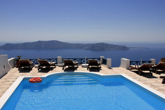On the top of the hill. Dream house set on a hill overlocking the sea (Santorini/Greece Stock Photos
