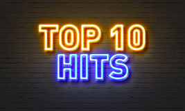 Top 10 hits neon sign on brick wall background. Stock Photography