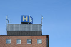 Top of Hospital Building. Hospital sign and telecommunions antennas atop hospital building royalty free stock photo
