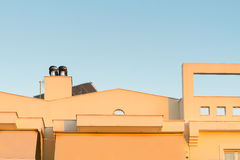 Top of a house with a chimney ventilator fan system. Royalty Free Stock Image