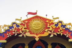Top jf the roof with Maslenitsa decorations: sun, colorful ribbons.  stock photos